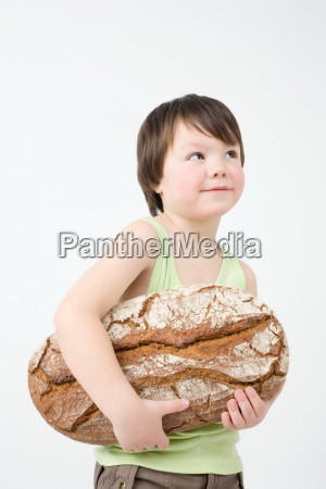 boy holding loaf of bread