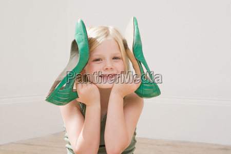 girl holding a large pair of