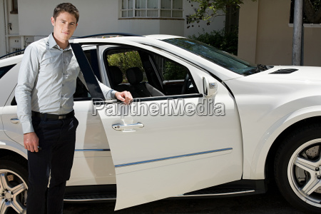 young man and car