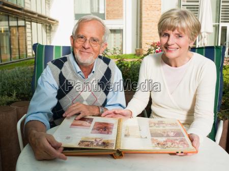 senior couple looking at a photo