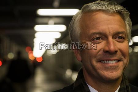 headshot of a smiling mature man