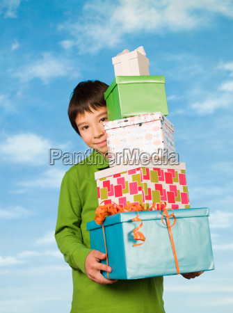a boy carrying presents