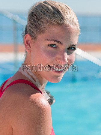 young woman at poolside portrait