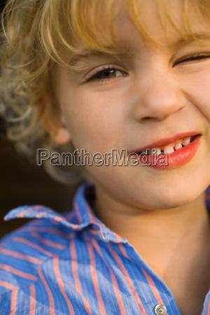 portrait of a boy winking