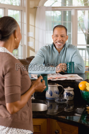 a senior couple in the kitchen