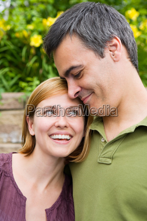 mid adult couple smiling