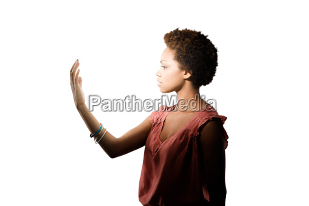 young woman looking at her hand