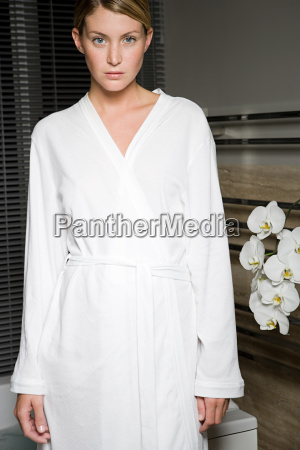 portrait of young woman in bathrobe