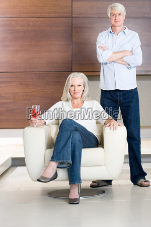 middle aged couple with glass of