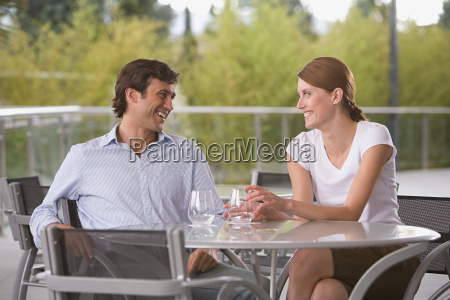 smiling couple at dining table