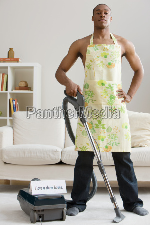 a man vacuum cleaning