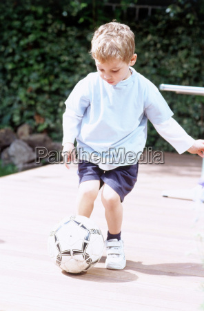 boy playing ball