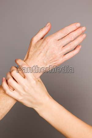 hands on young and older women