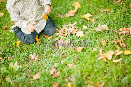 child with leaves