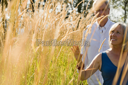 mature couple in field