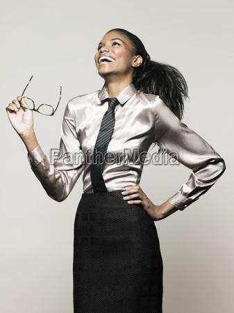 businesswoman holding glasses