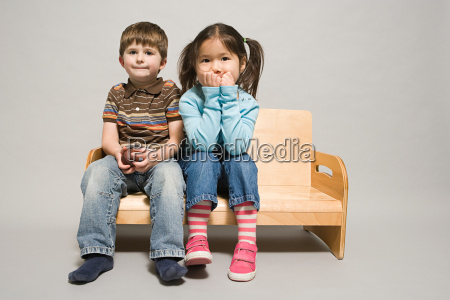 a boy and girl sat on