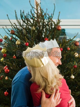 mature couple hugging at christmas