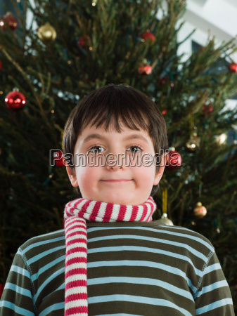 boy wearing a scarf at christmas