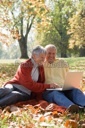 senior couple using a laptop in