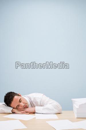 office worker sleeping on desk