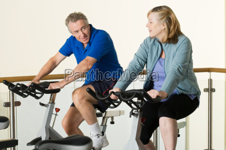 a man and woman using exercise