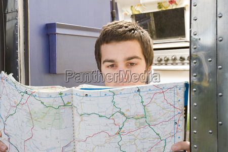 a teenage boy looking at a