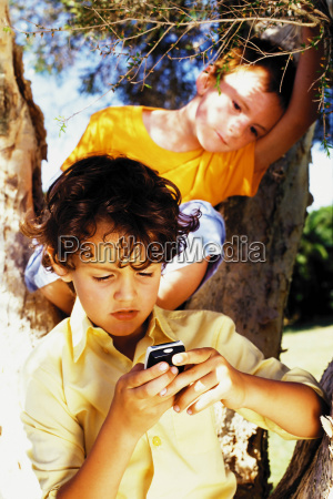 boys with a mobile phone