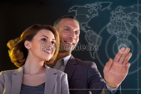 businesspeople touching world map