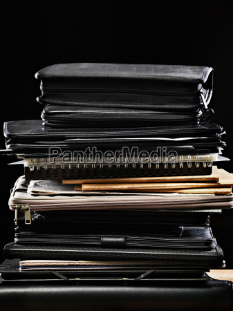 stack of binders and files