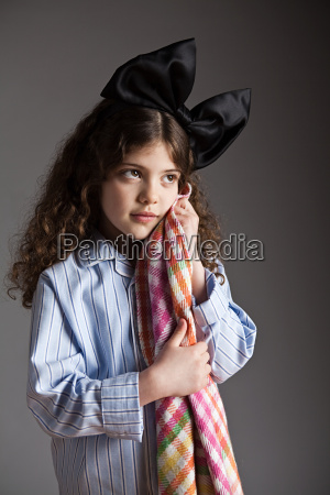 young girl dressed in pyjamas with