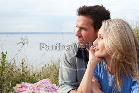 couple outdoors looking towards sea