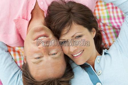 couple lying on blanket