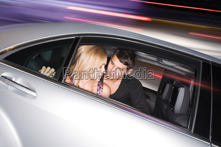 young couple in a speeding car
