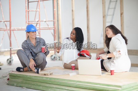 designers and construction worker taking a