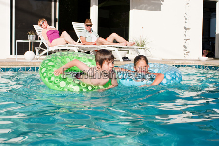 family and outdoor swimming pool