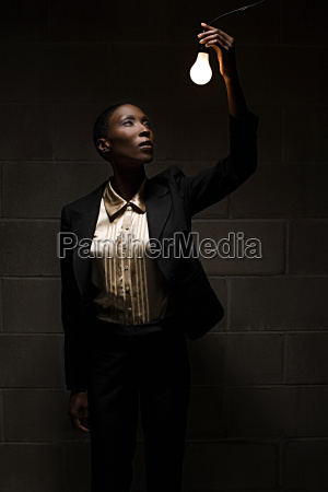 businesswoman holding lightbulb