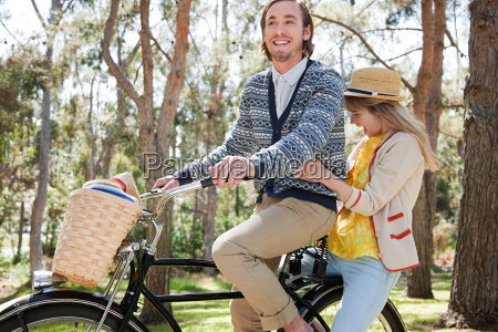 young couple on a bicycle
