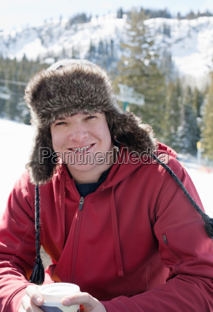 young man wearing furry hat