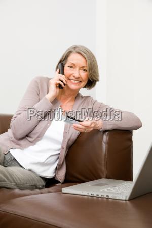 mature woman using telephone banking