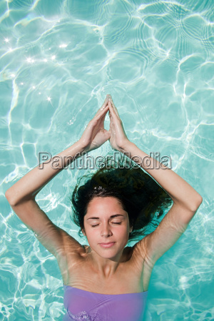 serene woman in swimming pool