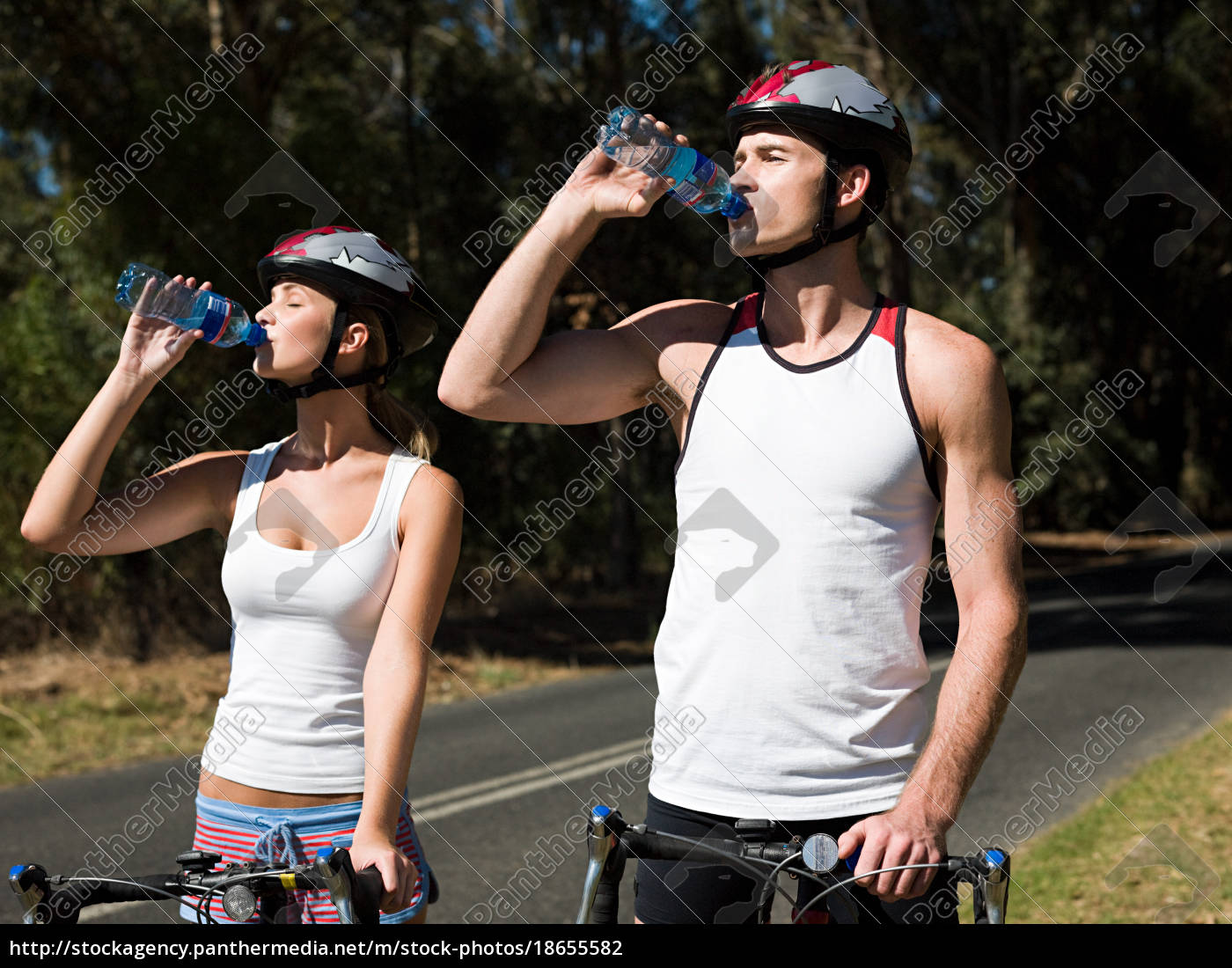 young, couple, cycling, on, road - 18655582