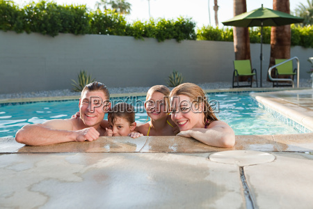 family in outdoor swimming pool portrait