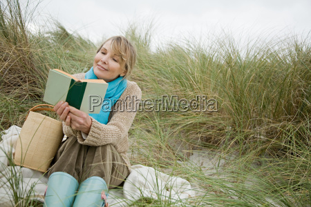 woman reading a book on a