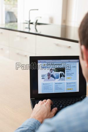 young man looking at car insurance