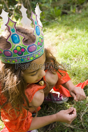 girl wearing crown dressed up as