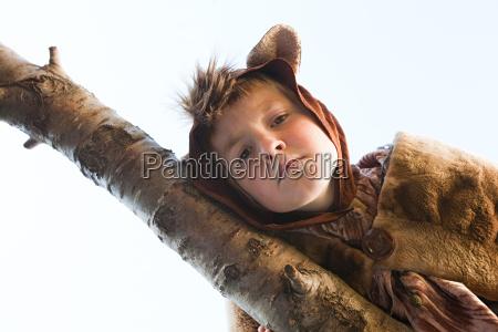boy dressed up as bear on