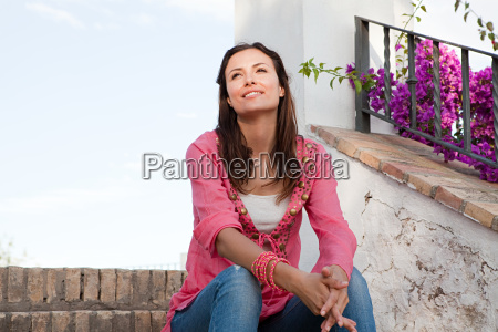 young woman sitting on steps