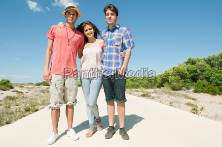 young friends standing on rural road