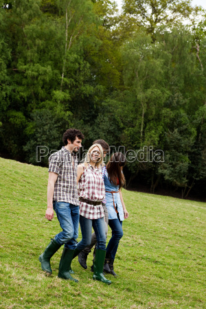 young adult friends walking down hill